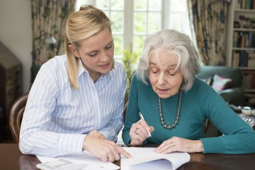 Woman Helping Senior